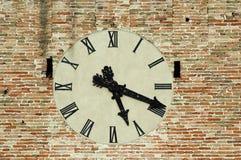 Antique clock on a building. Stock Photos