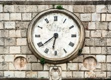 Antique clock on a building. Royalty Free Stock Photo