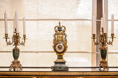 Antique clock and candles Royalty Free Stock Photography