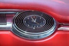 Antique clock in car dash Royalty Free Stock Photo