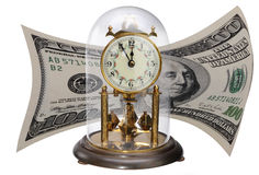 Antique clock and dollar bill. Antique clock in glass globe with one hundred American dollar banknote in background, isolated on white. Time is money concept Royalty Free Stock Images