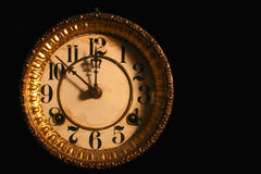 Antique clock face. Antique clockface on black Royalty Free Stock Images