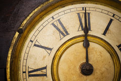 Antique Clock Face. An Antique Clock Face with gold gilding and roman numerals Royalty Free Stock Photography