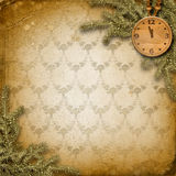Antique clock face with and firtree. On the abstract background Stock Images