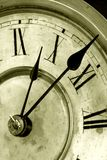 Antique clock face with hands stock photography