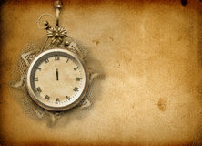 Antique clock face with lace and firtree Stock Images