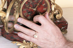 Antique clock give birth to a key Stock Photography