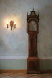 Antique clock. Antique grandfather clock and lamp Stock Images