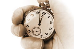 Antique clock in hand Royalty Free Stock Photo