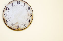 Antique clock hanging on the wall. Royalty Free Stock Photos