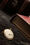 Antique clock. Historical automatic watch with a book in the background Stock Photo
