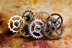Antique clock mechanism steampunk style cogs gears wheels macro view. Vintage rusty metal surface background, shallow Stock Photo