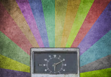 Antique Clock on multicolor sunbeams Royalty Free Stock Photography