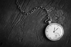 Antique clock on an old chain Royalty Free Stock Photos