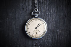 Antique clock on an old chain Stock Photos