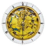 Antique clock with open innerworks and gear wheels isolated on w Stock Photography