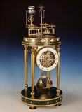 Antique clock with perpetual motion. Stock Photography