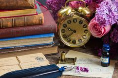 Antique  clock with pile of mail Royalty Free Stock Image