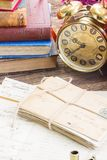 Antique  clock with pile of mail Stock Photography