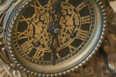 Antique clock with roman numerals Royalty Free Stock Images