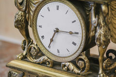 Antique clock with roman numerals Royalty Free Stock Image