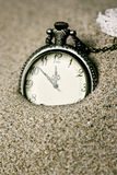 Antique clock in the sand. Detail Royalty Free Stock Photos