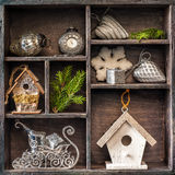 Antique clock, sleigh Santa Claus and  birdhouse. Royalty Free Stock Images