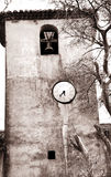 Antique clock tower in France. Clock tower inside the Fort de L'Ile Sainte-Marguerite, contrasty sepia Royalty Free Stock Photos