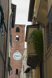Antique clock tower in Lucca. Tuscany. Italy. stock image