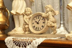 Antique clock with two figures of angels Royalty Free Stock Image