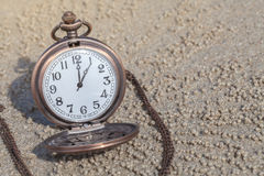 Antique clock vintage. On sand Stock Photos