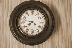 Antique clock on the wall Stock Image