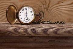 Antique clock on wood Stock Photography
