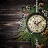 Antique clock on the wooden bakgrond Royalty Free Stock Image