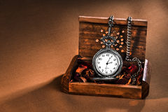 Antique clock in wooden box. And taillight Royalty Free Stock Photo