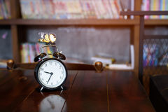 Antique clock. Antique clock on a wooden table royalty free stock images
