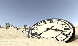 Antique Clocks In Desert Sand Stock Photo