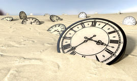 Antique Clocks In Desert Sand Royalty Free Stock Photo