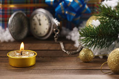 Antique clocks, spruce branch, candle, Christmas decorations Royalty Free Stock Photography