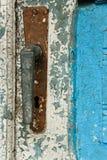 Antique closed door with metal door handle and vibrant white-blu paint stock photo