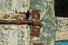 Antique closed door with metal door handle and vibrant white-blu paint royalty free stock photo