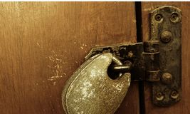 Antique lock and hinge on wood stock illustration