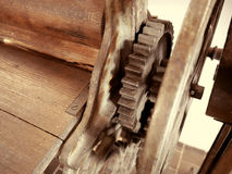 Antique clothes dryer. Old machinery details closeup. Rusty gear wheels. Toned style photo royalty free stock photography