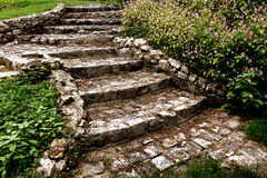 Antique Cobblestone Stairway in Landscaped Garden Royalty Free Stock Photos