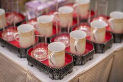 Antique Coffee Cup arrange for service in Chinese style for ceremony. Set of Coffee cup and glass on tray. Prepare for service to monk in Thai culture. Thai Stock Image