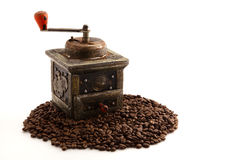 Antique coffee grinder. Old coffee grinder with coffee beans for context, isolated on white Stock Image