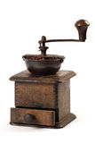 Antique coffee grinder. Photo of an antique coffee grinder isolated on a white background royalty free stock image