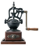 Antique coffee grinder. Showing external moving parts and drawer to remove ground coffee, white background stock photo