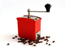 Antique coffee grinder. Antique bakelite coffee grinder with coffee beans stock images