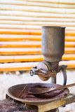 Antique Coffee Grinder. Classic Antique Coffee Grinder in countryside stock photos